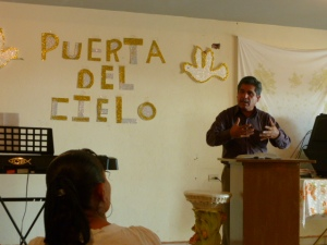 "President of the ICDC Disciples Pastor Manuel Tovar preaches at a ""house church"" in Aguascalientes"