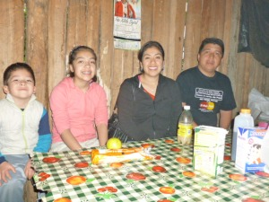Pastor Josue Martinez Cisneros, President of CICE Disciples, with family at breakfast in a church member's home in the Huasteca Region