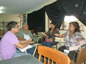 Pastor Agustin Martinez of Salem, OR (in green shirt) participates in small group working on exegesis of the book of Ruth