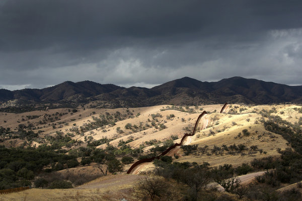 The U.S.-Mexico border fence stretches into the countryside on near Nogales, Ariz. (John Moore / Getty Images / March 8, 2013)