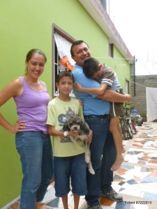 Pastor Victor C., Jessie, Elias and a tired Isais outside their new Villa Union home