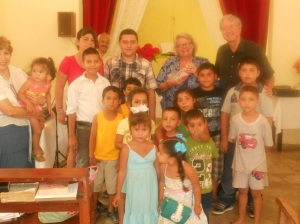 Pozole youth and children with Pastor Miguel Villa in back and Maribel on left