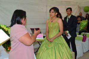 Marisol of Julien Carrillo Church gives Heidi a Bible