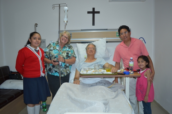 Dr. Mercado's Pastor Rogelio Espino Flores with daughters and Kate.  Total cost of my six night stay in Oli Med Hospital came to less than $4000.