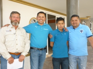 Jim Piper, Idaho Disciple, Global Ministries service volunteer,  with three members of the Ortiz family at the Ortiz Machinery plant