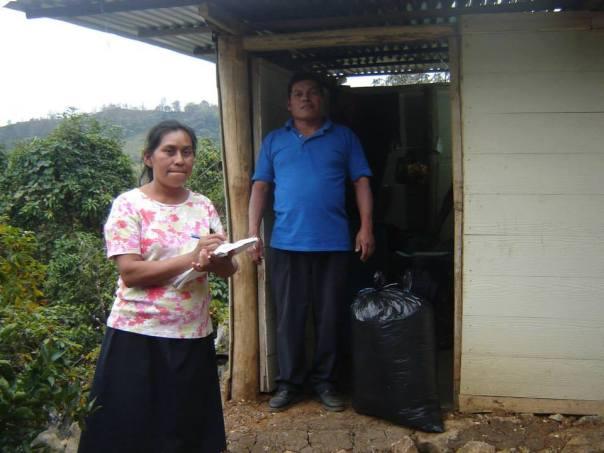 Dolores purchasing coffee from a La Joya household