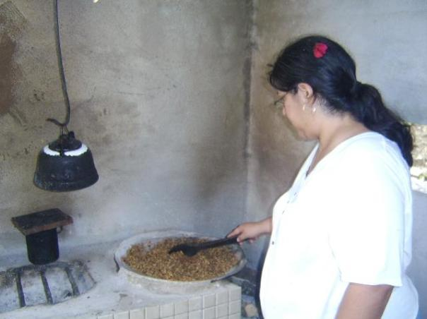 Toasting the coffee beans on a hot comal