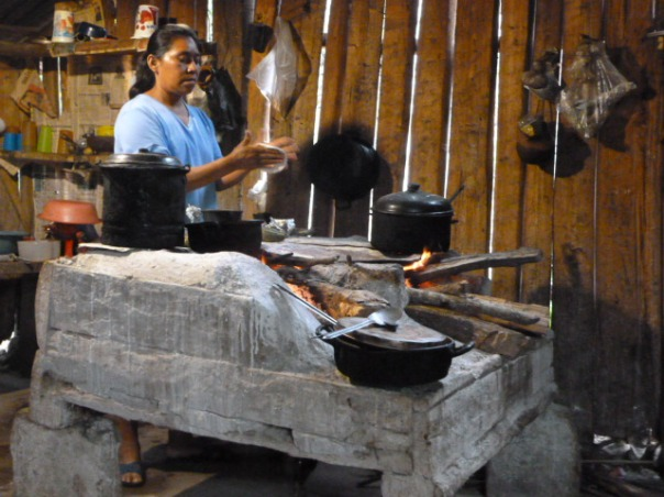 Coffee Project Coordinator Dolores Anaya in her kitchen. Grinder for coffee is seen in background with a bowl cover.