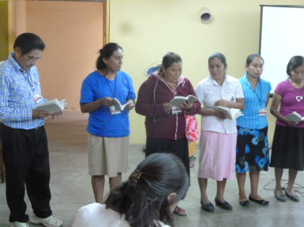 The La Joya delegation at the Mujer a Mujer event prepare to sing in  Spanish although they mostly use Nahuatl in their worship