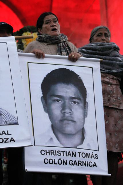 Is she a mother? an Aunt? an Activist? Whoever she may be, she holds this Ayotzinapa student in her heart.