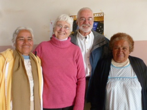 Fred and Mary greeting two of the La Reforma members who prepared the post-worship meal