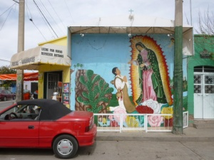 Sylvia and Coco's corner grocery bears this mural of the Virgin of Guadalupe
