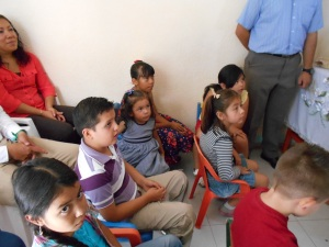 Children sit in front and participate in worship