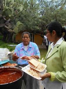 mother and daughter plating the food