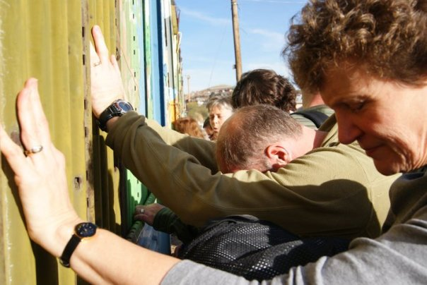 Praying at the Mexican border.  Photo from United Church of Christ News.