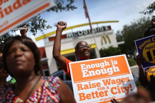 Outside a McDonald's in Fort Lauderdale, Florida, protesters rally in support of a $15 an hour minimum wage. Photo by Joe Raedle/Getty Images